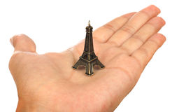 Hand showing a tiny Eiffel Tower Stock Image