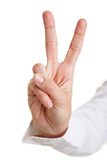Hand showing victory sign Royalty Free Stock Photo