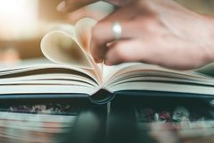 Shape of a heart on a book at coffee cafe stock photography