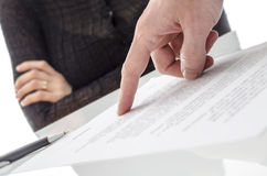 Hand showing a woman to sign a paper Stock Photo