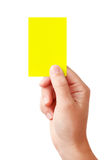 Hand showing yellow card Stock Photos
