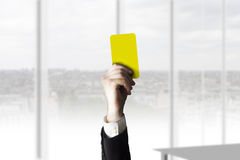 Hand showing yellow card office Stock Photo