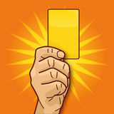 Hand showing the yellow card Stock Photography