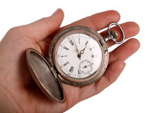 Hand shows antique pocket watch. Isolated on white Stock Photography