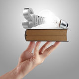 Hand shows book of  success Royalty Free Stock Photography