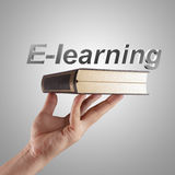 Hand shows a e-learning word Stock Image
