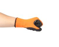 Hand shows fist in black and orange rubber glove. Royalty Free Stock Photography