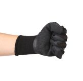 Hand shows fist in a black rubber glove Royalty Free Stock Photo