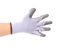 Hand shows five in rubber glove. Royalty Free Stock Image