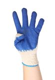 Hand shows four in a blue rubber glove Stock Image