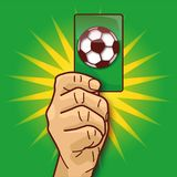 Hand shows a green card with a soccer ball royalty free illustration