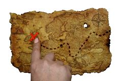 Hand shows index finger on old map on yellowed parchment royalty free stock photos