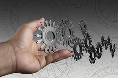 Hand shows people cogs as concept. Businessman hand shows people cogs as concept Royalty Free Stock Images