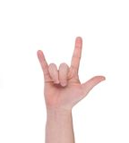 Hand shows the rock and roll sign. Royalty Free Stock Photography