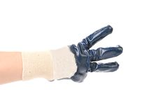 Hand shows three in rubber glove. Stock Photo