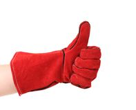 Hand shows thumb up in glove. Stock Photo