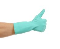 Hand shows thumb up in rubber glove. Stock Images