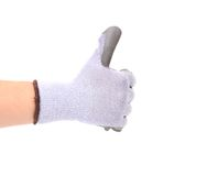 Hand shows thumb up in rubber glove. Royalty Free Stock Image