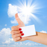 Hand shows thumbs up, Sky and sun Royalty Free Stock Images