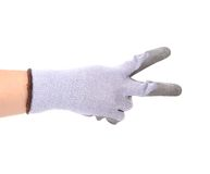 Hand shows two in rubber glove. Stock Images