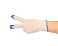 Hand shows two in rubber protective glove Stock Photography