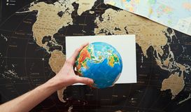 The hand shows on the world map. Mocap stock image