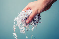 Hand with shredded paper Royalty Free Stock Photos
