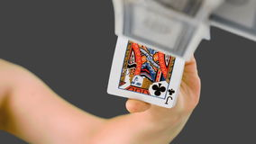 Hand shuffling and pushing cards towards the camera Royalty Free Stock Photos