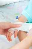 Hand of sick little girl Stock Image
