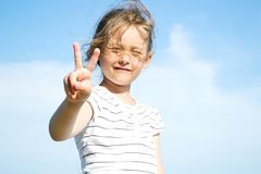Hand sign. Girl shows a hand sign Stock Photos