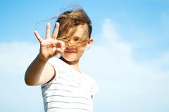 A hand sign. Girl shows a hand sign Royalty Free Stock Image