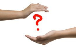 Hand sign. With question mark in background Stock Photo