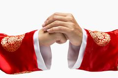 Hand sign. A warm greeting hand sign with traditional chinese cloth Royalty Free Stock Images