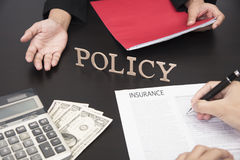 Hand sign contract life insurance policy. With agent Stock Photos