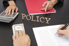 Hand sign contract life insurance policy Stock Image