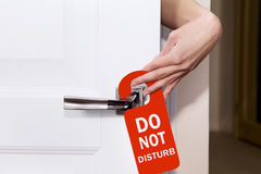 Hand sign do not disturb. Put on the room doors Royalty Free Stock Photos