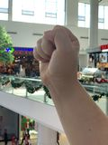 Hand sign in the mall background stock photography