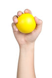 Hand sign posture hold yellow ball yellow isolated Stock Photos