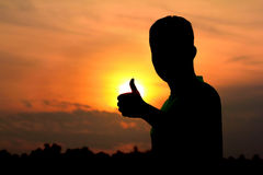 Hand sign silhouette Stock Photography