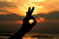 Hand sign silhouette Stock Images