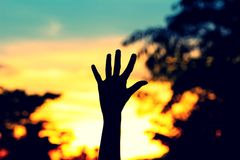 Hand sign silhouette with sunset background Royalty Free Stock Photo