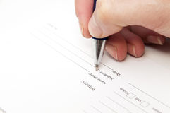 Hand signing an agreement Royalty Free Stock Image