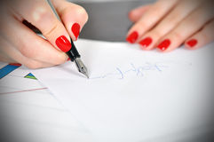 Hand signing Stock Photos