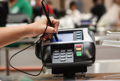 Hand signing in a card payment machine POS Stock Photography