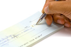Hand signing cheque Stock Photos