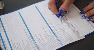 Hand signing a contract in blue ink stock footage