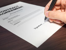 Hand signing contract with a pen macro Stock Images