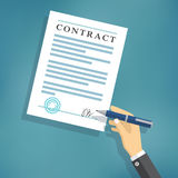 Hand signing contract on white paper. Stock Images
