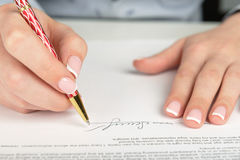 Hand signing a contract Stock Image