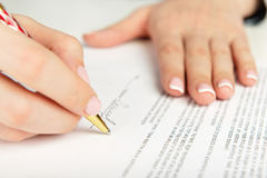 Hand signing a contract Stock Photography